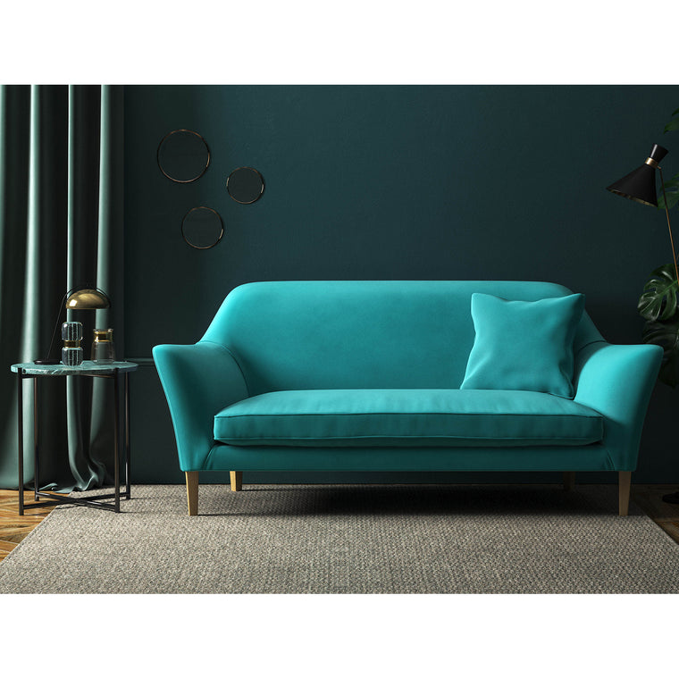 Sofa in a turquoise velvet upholstery fabric with a stain resistant finish