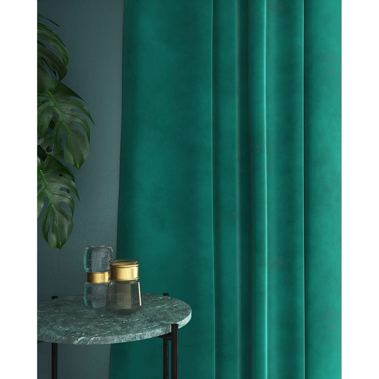 Curtain in a turquoise velvet fabric for domestic and contract use