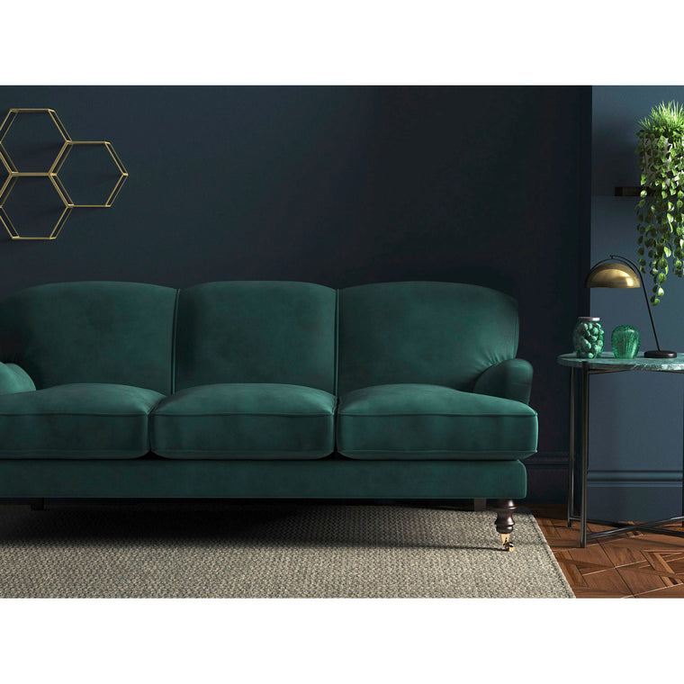 Sofa in a ocean blue velvet upholstery fabric with a stain resistant finish