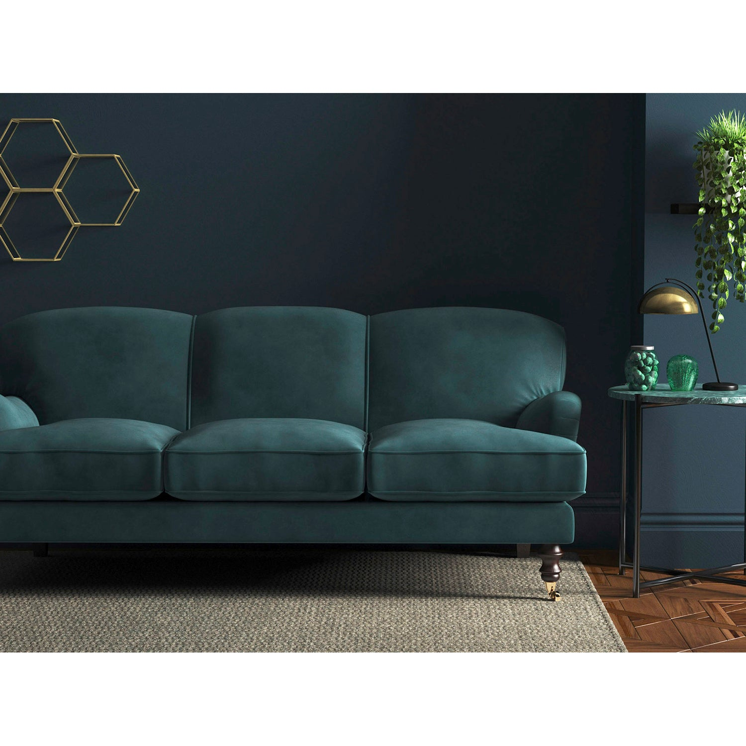 Sofa upholstered in a blue velvet fabric with a stain resistant finish