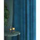 Curtain in a sky blue velvet fabric with a stain resistant finish