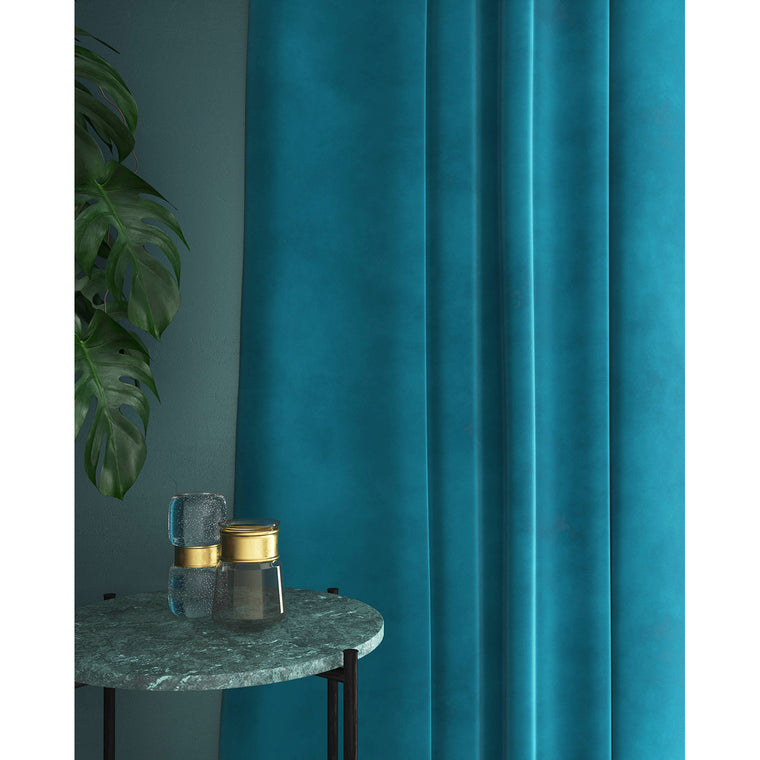 Bright blue velvet curtains with a stain resistant finish