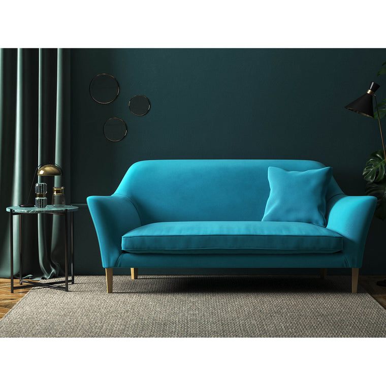 Sofa in a tropical blue velvet upholstery fabric with a stain resistant finish
