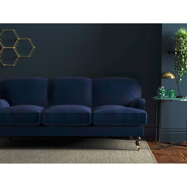 Sofa in a dark blue upholstery fabric with a stain resistant finish