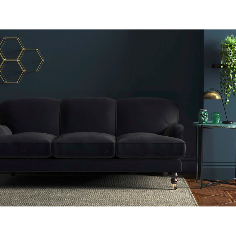 Sofa in a midnight blue velvet upholstery fabric with a stain resistant finish