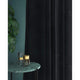 Curtain in a midnight blue velvet fabric for contract and domestic use