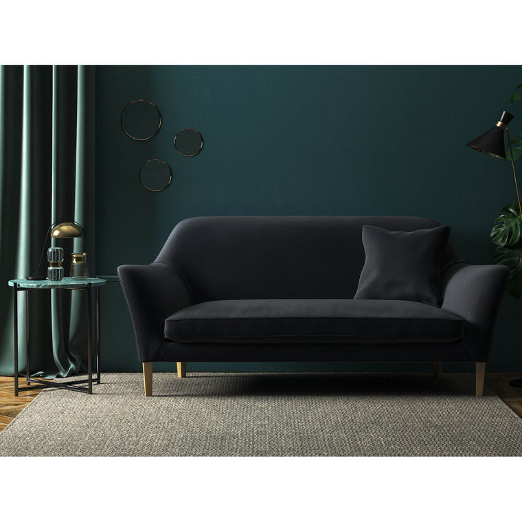 Black velvet sofa with a stain resistant finish