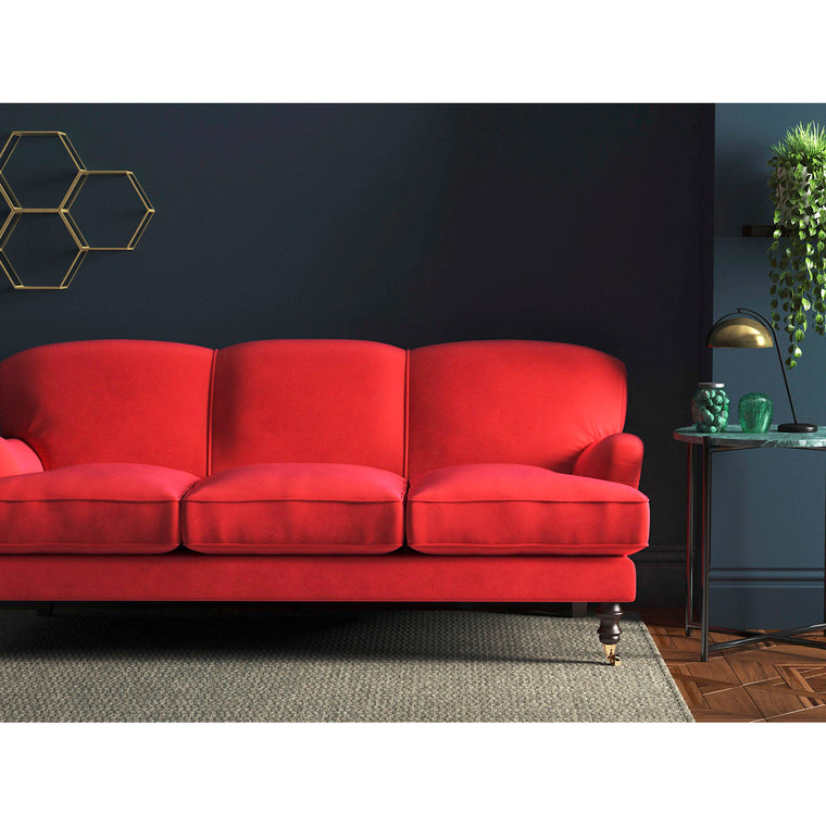 Sofa in a bright neon orange velvet upholstery fabric with a stain resistant finish