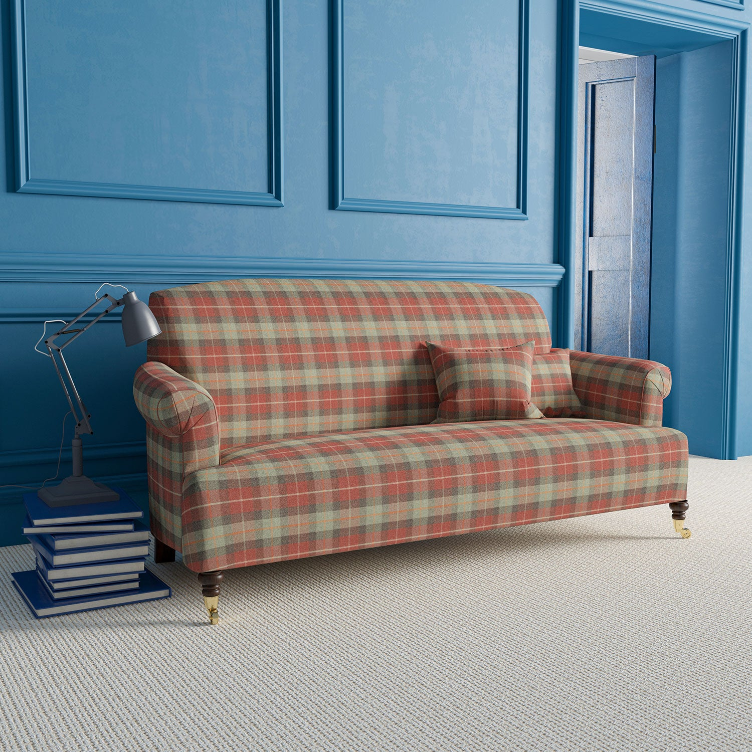 Sofa upholstered in a red and green wool check fabric.