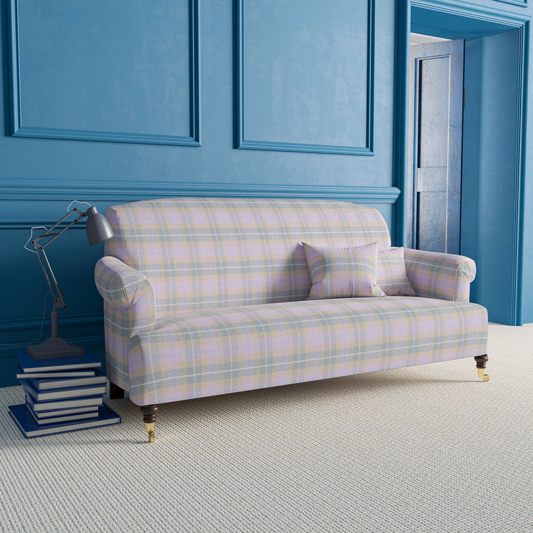 Sofa upholstered in a lilac and grey wool check fabric.