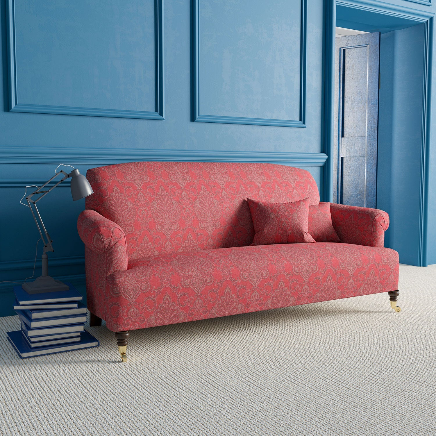 Sofa upholstered in a red fabric with mauve and grey large scale damask print.