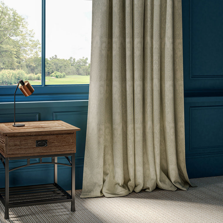 Curtains with neutral fabric and large woven damask design.