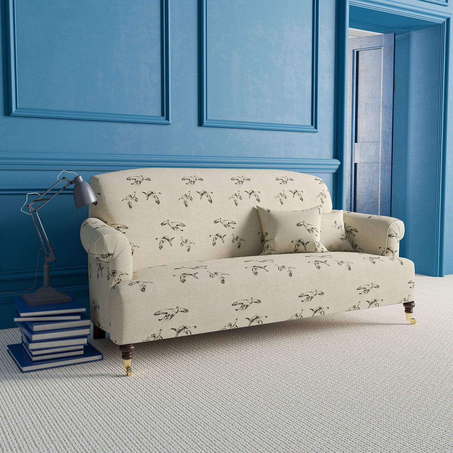 Sofa upholstered in neutral linen fabric with grey illustrated Grouse bird design.