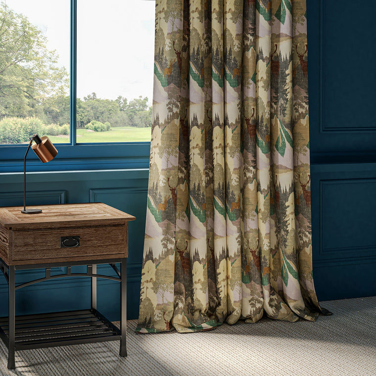 Curtains in a cotton velvet fabric with mountain scene and stag design with green and lilac colour palette.