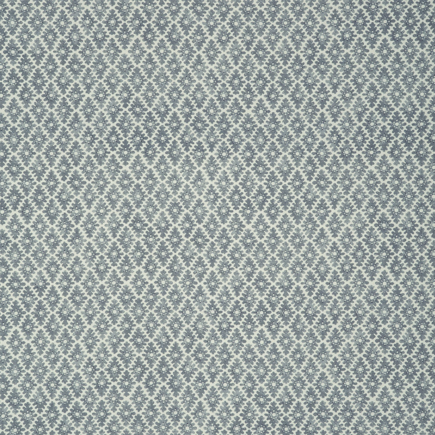 Fabric sample of a denim blue and neutral printed linen fabric for curtains and upholstery