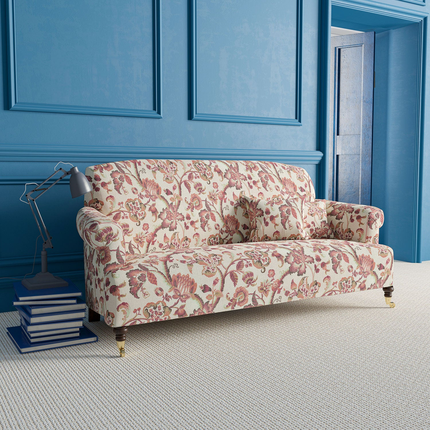 Sofa upholstered in neutral fabric with red and terracotta vine and floral design. Design name - Haryana. Colourway - Jaipur