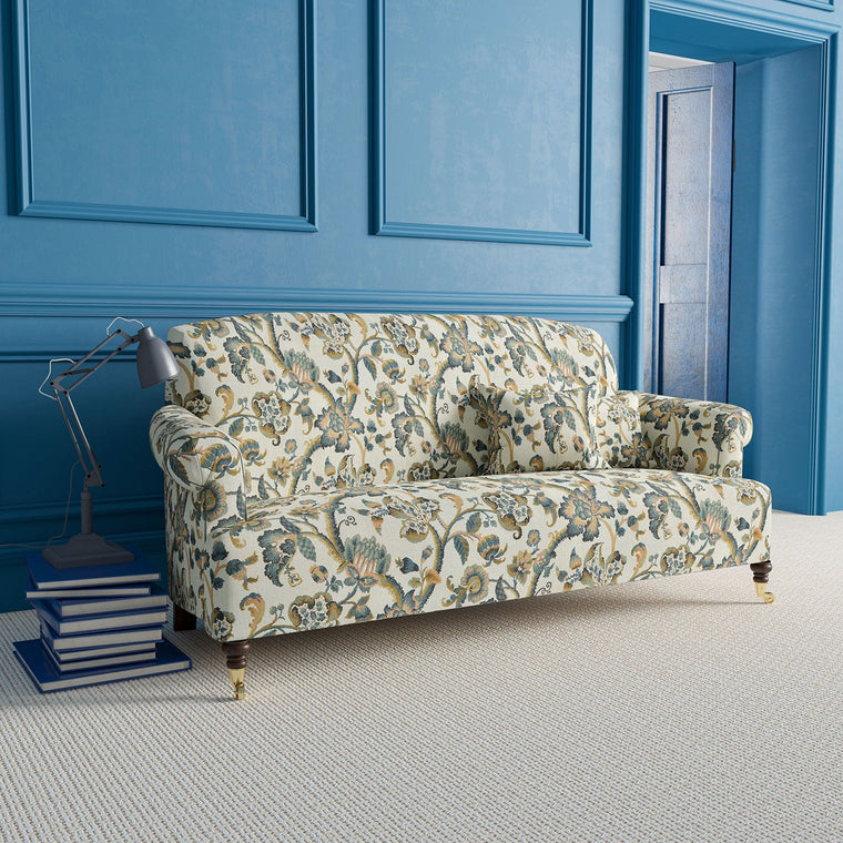 Sofa upholstered in Haryana fabric with blue and neutral vine design