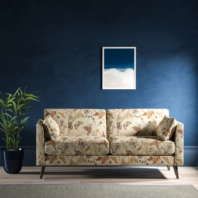 Sofa with a cream fabric with a stylised floral design