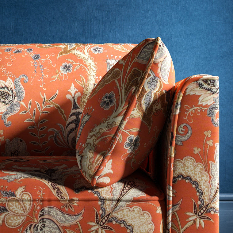 Sofa with a orange fabric with a stylised floral design