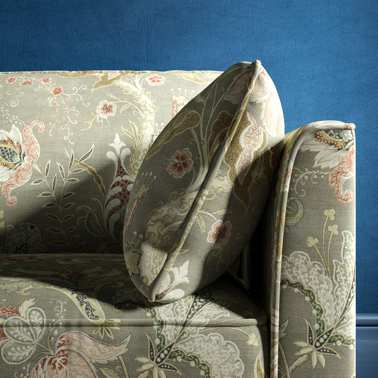 Sofa with a grey fabric with stylised floral design