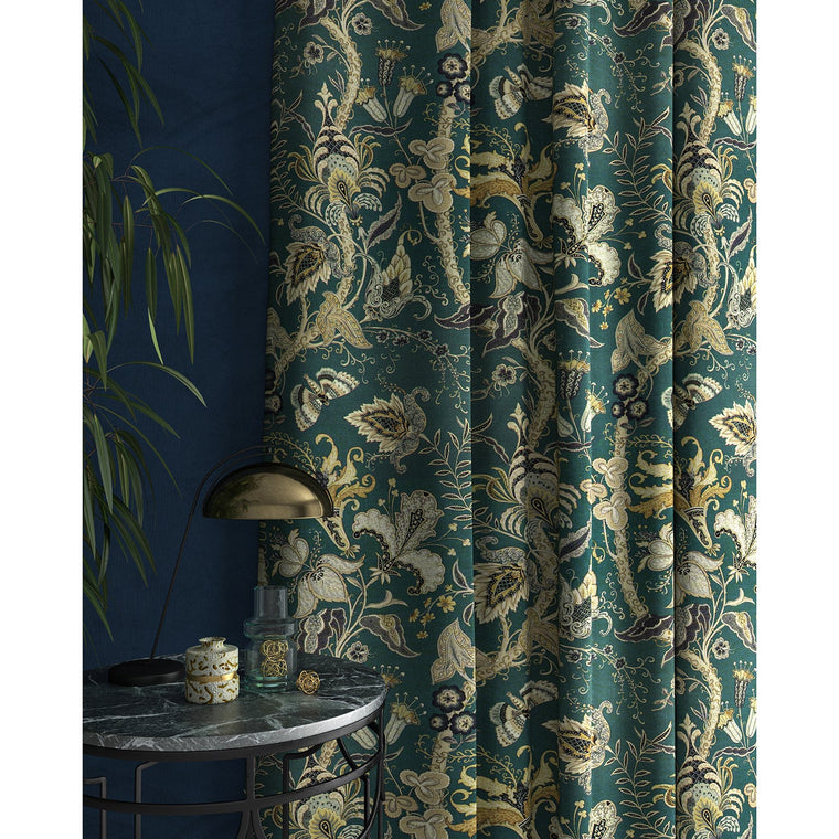 Curtains with a blue fabric with stylised floral design