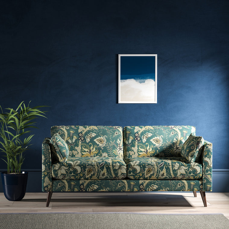 Sofa with a blue fabric with stylised floral design