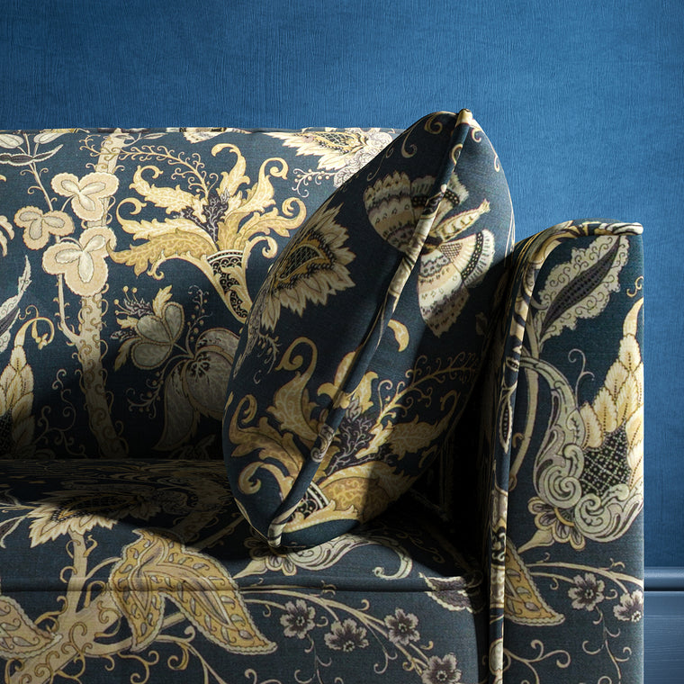 Sofa with a navy blue fabric with stylised floral design