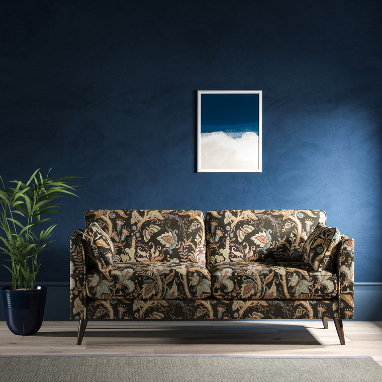 Sofa with a dark grey fabric with stylised floral design