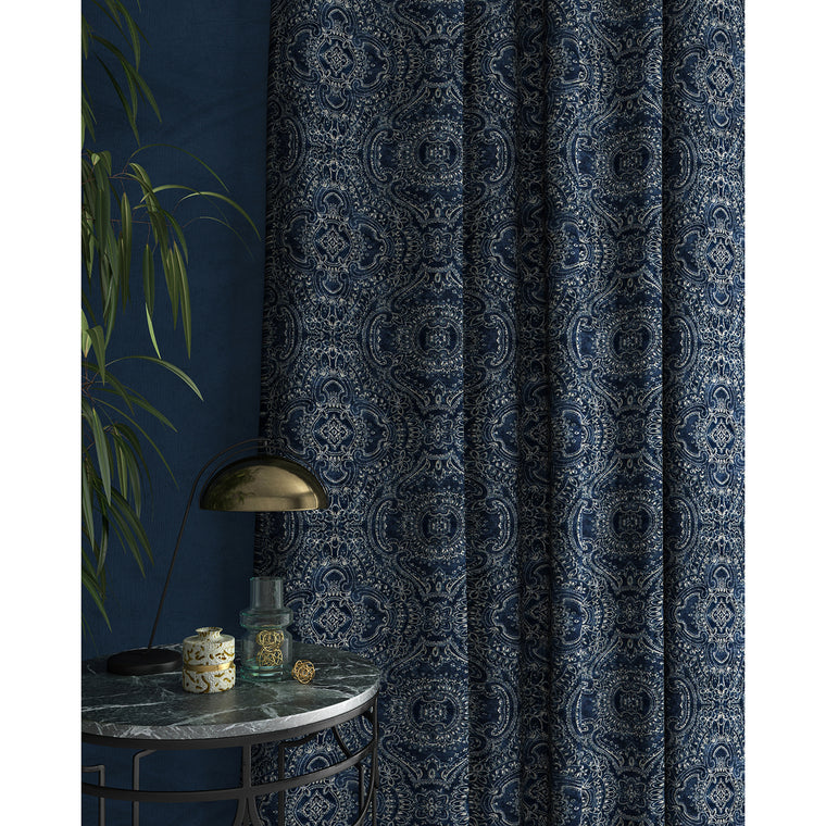 Curtain in a indigo blue and white velvet fabric with intricate jewel design