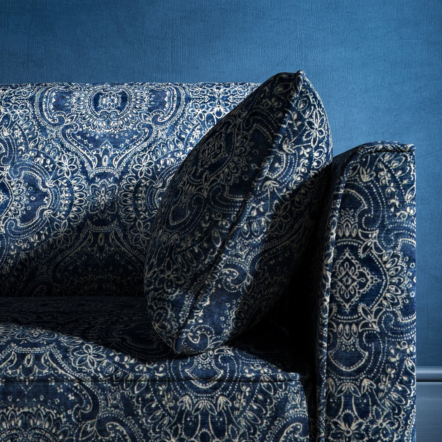 Sofa upholstered in a indigo blue upholstery fabric with intricate jewel like design