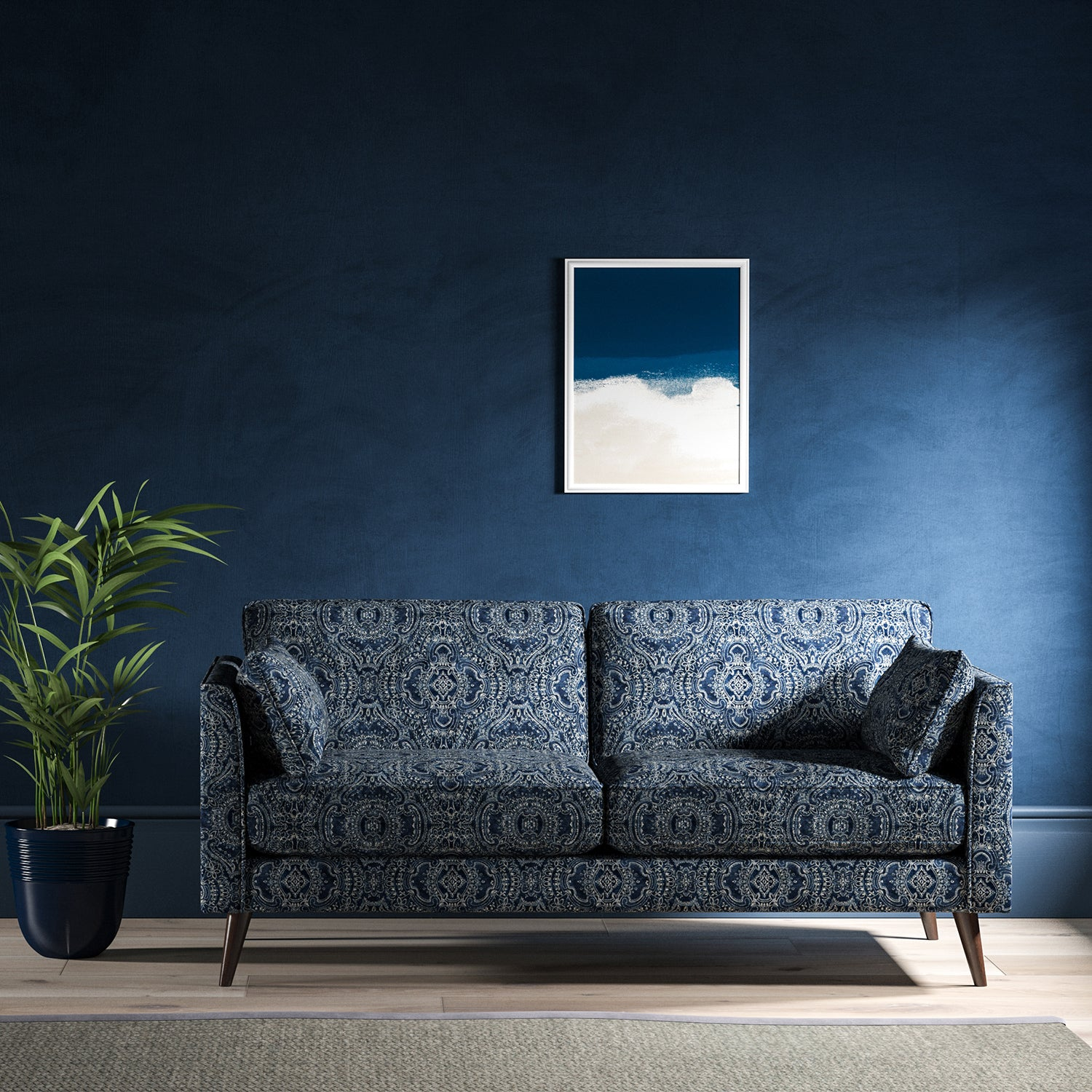 Sofa upholstered in a indigo blue velvet upholstery fabric with intricate jewel like design