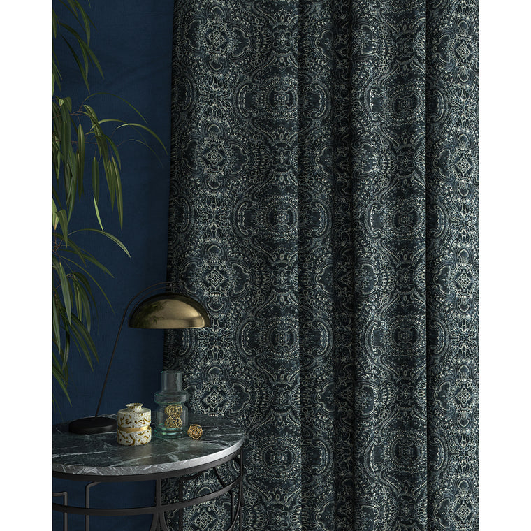 Curtain in a dark blue and white velvet fabric with intricate jewel design