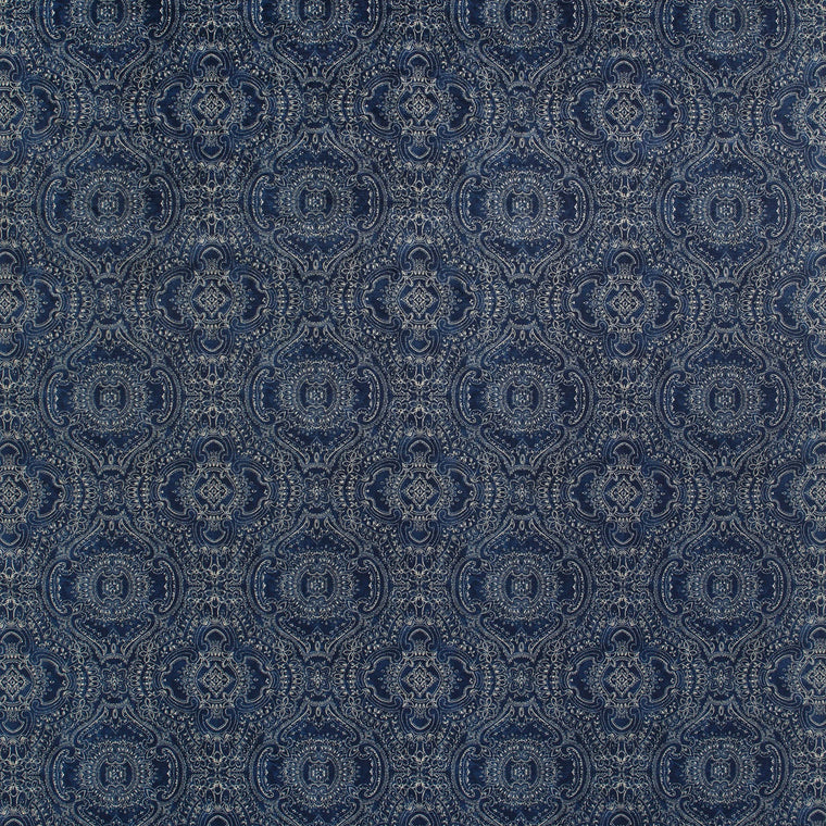 Fabric swatch of a indigo blue velvet fabric for curtains and upholstery with intricate jewel like design