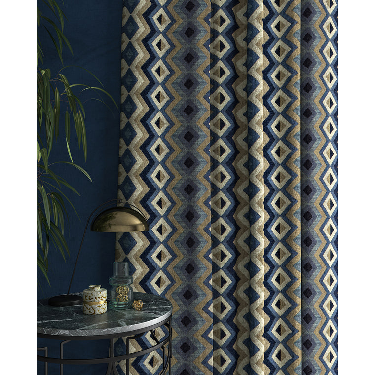 Curtain in a blue and neutral fabric with geometric Navajo inspired design