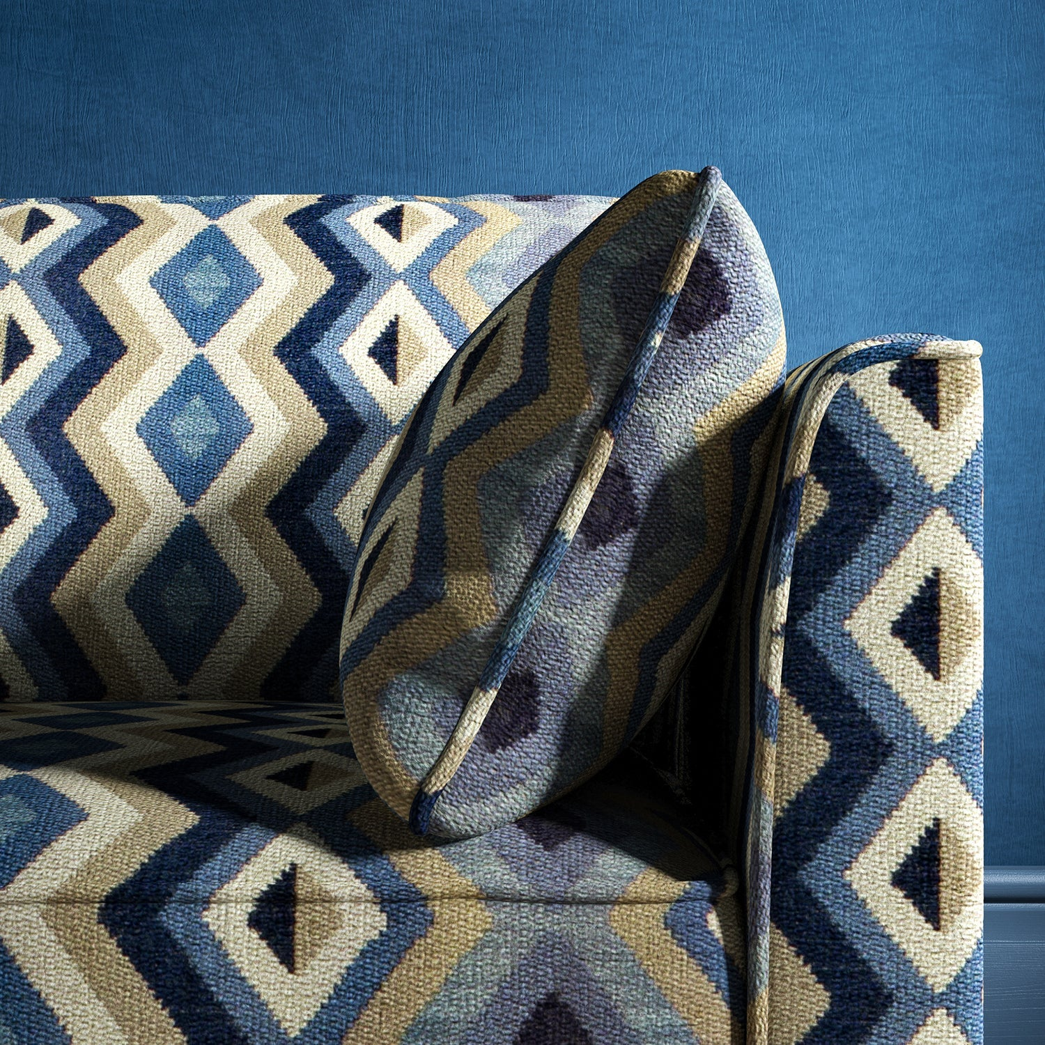 Sofa upholstered in a blue and neutral upholstery fabric with geometric Navajo inspired design