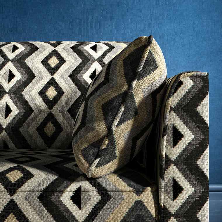Sofa upholstered in a black and white upholstery fabric with geometric Navajo inspired design