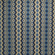 Fabric swatch of a blue and neutral fabric for curtains and upholstery with geometric Navajo inspired design