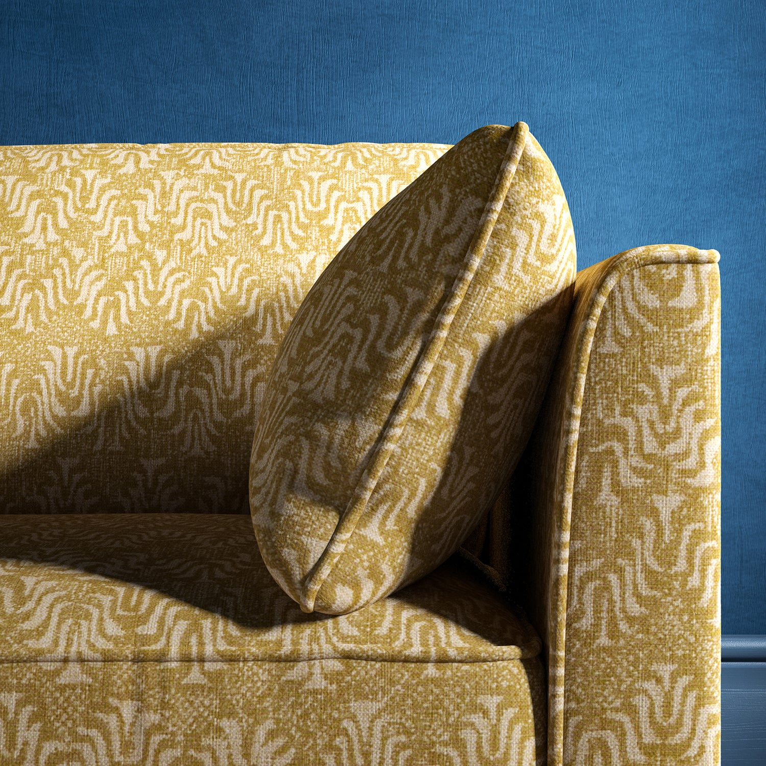 Sofa upholstered in a yellow and neutral jacquard weave upholstery fabric