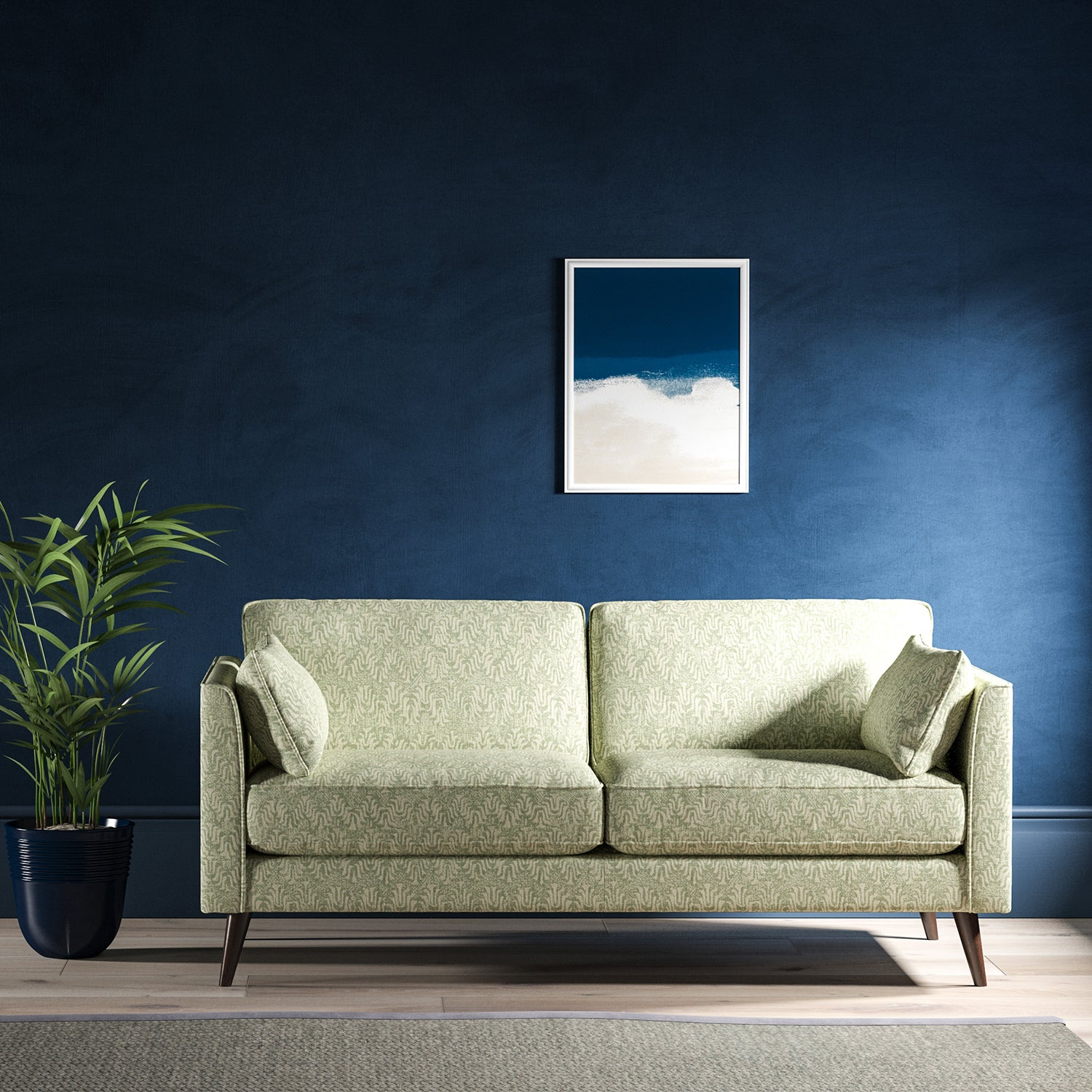 Sofa upholstered in a light turquoise and neutral jacquard weave upholstery fabric
