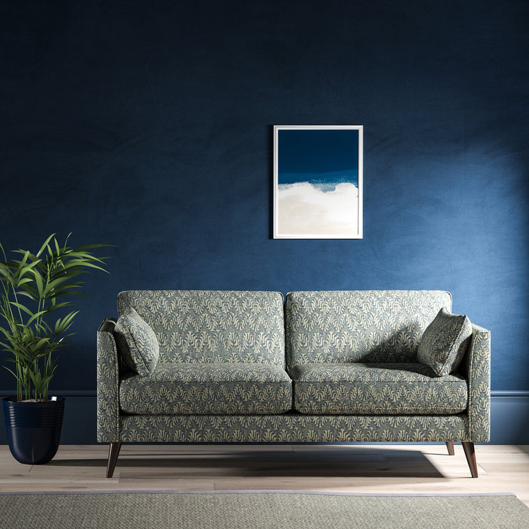 Sofa upholstered in a blue and neutral jacquard weave upholstery fabric