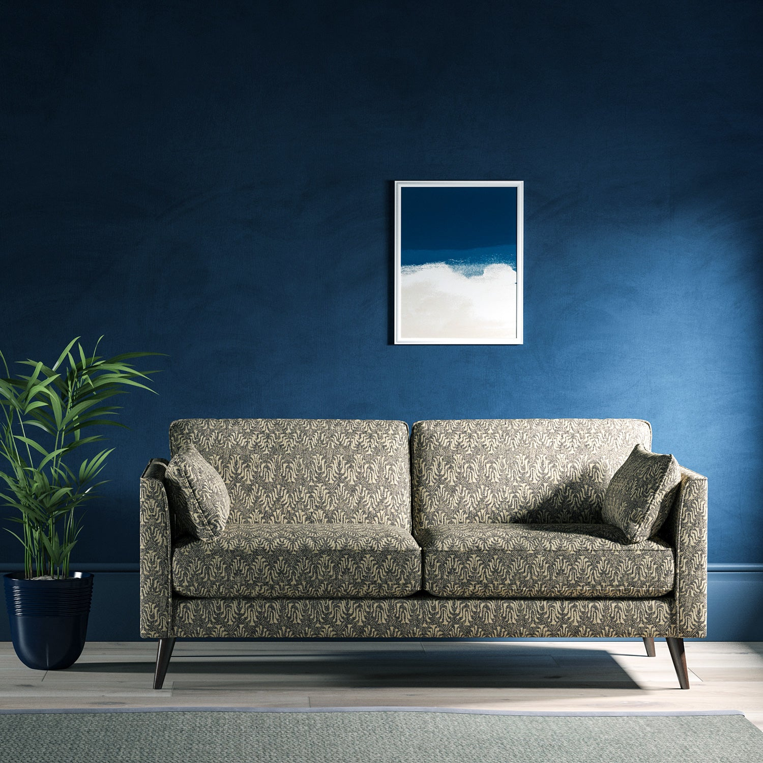 Sofa upholstered in a dark grey and neutral jacquard weave upholstery fabric