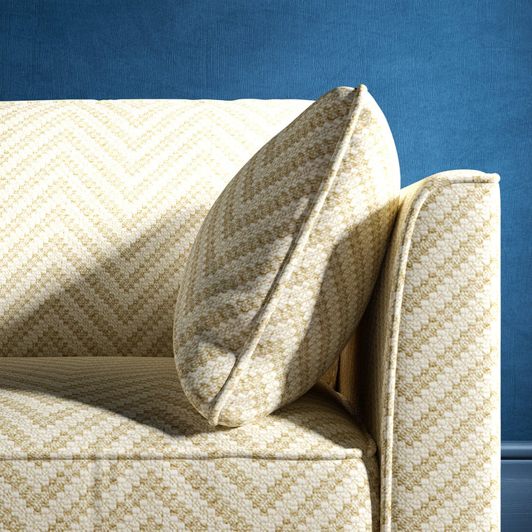 Sofa upholstered in a neutral herringbone upholstery fabric