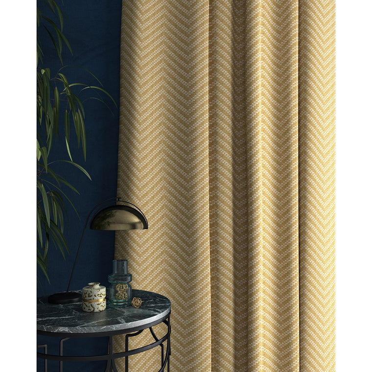 Curtain in a light yellow and neutral herringbone weave fabric