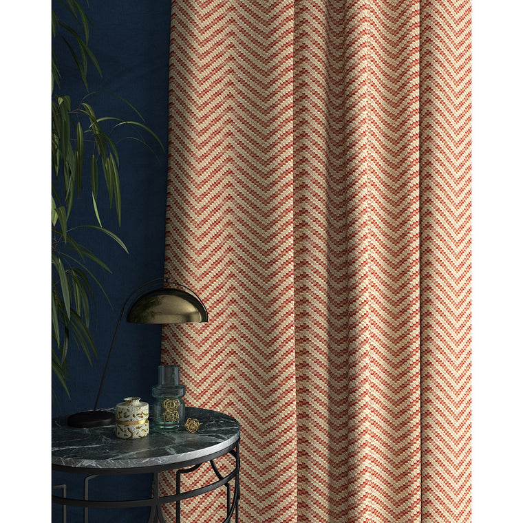 Curtain in a red and neutral herringbone weave fabric