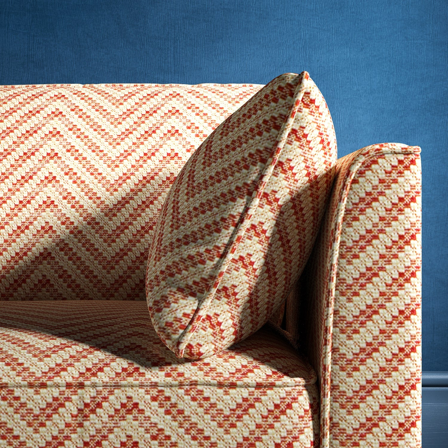 Sofa upholstered in a red and neutral herringbone upholstery fabric