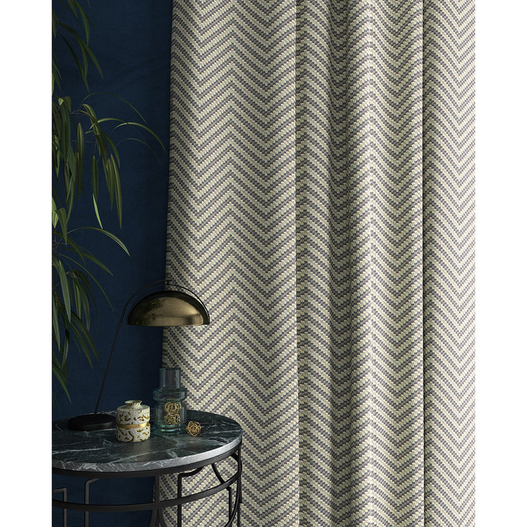 Curtain in a grey and neutral herringbone weave fabric