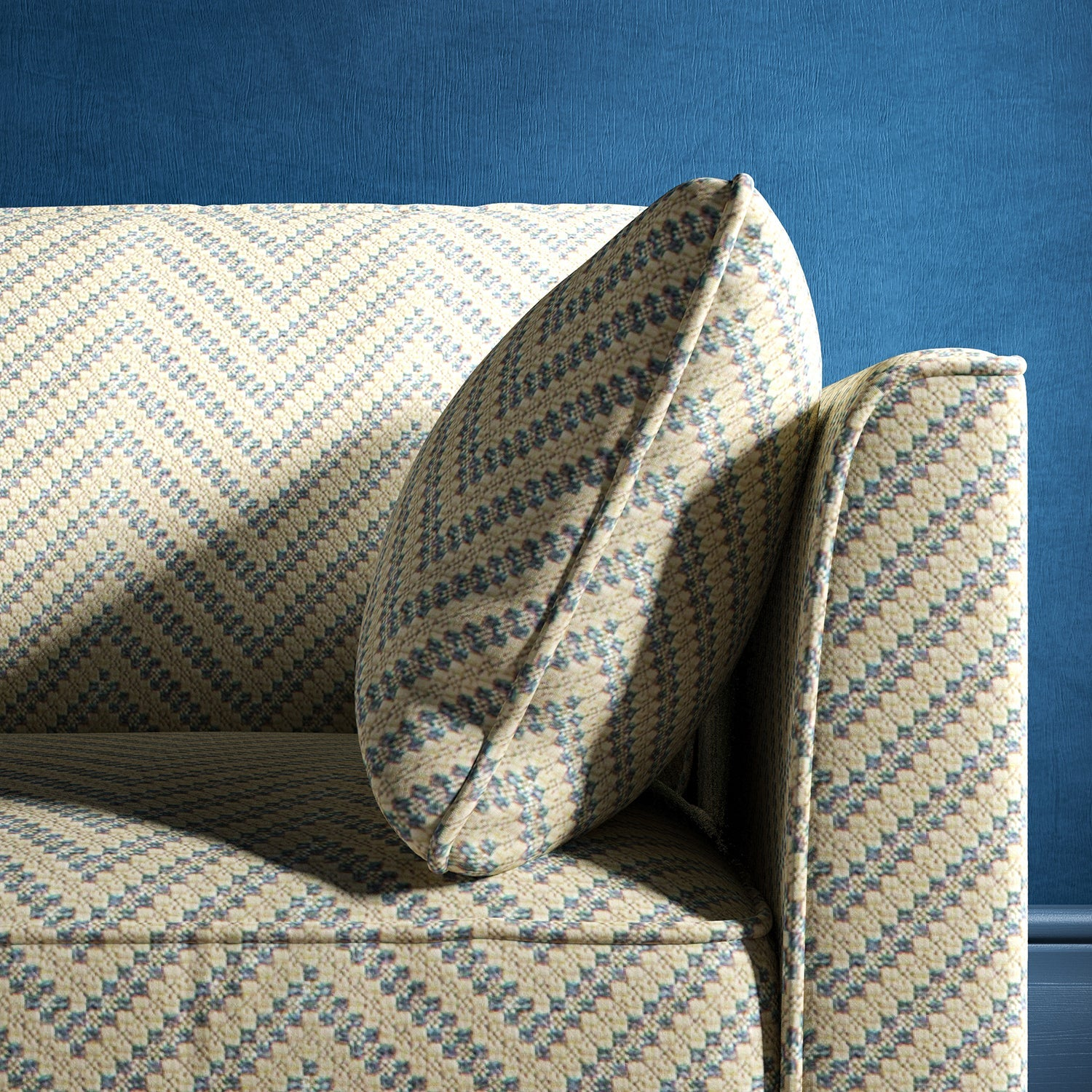Sofa upholstered in a light blue and neutral herringbone upholstery fabric