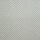 Fabric swatch of a light blue and neutral herringbone weave fabric for curtains and upholstery