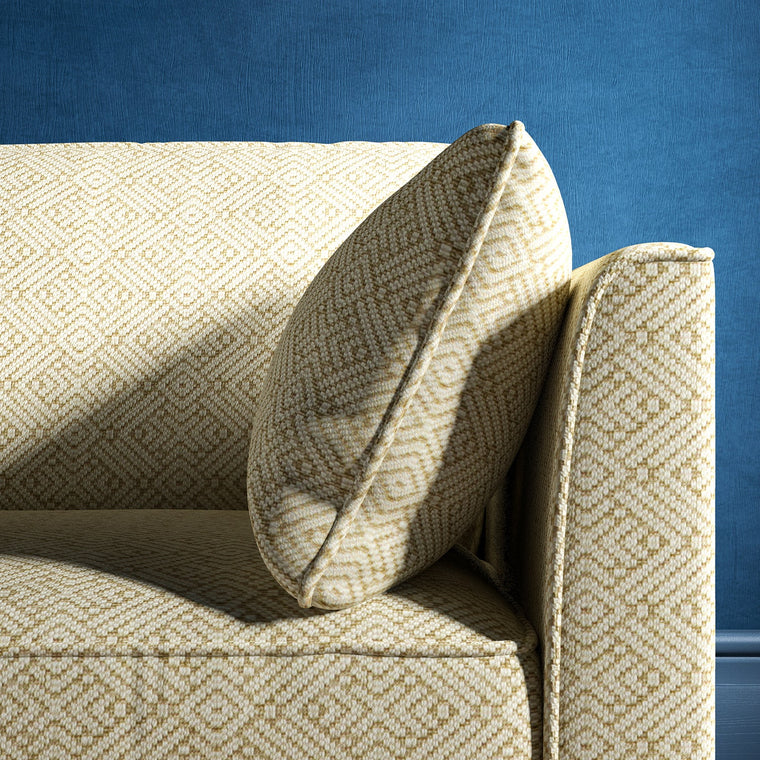 Sofa upholstered in a neutral geometric weave upholstery fabric