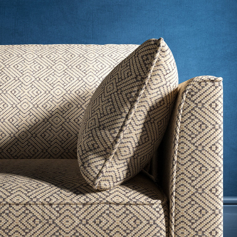 Sofa upholstered in a grey and neutral geometric weave upholstery fabric